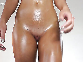Oiled nympho Jati exposes her small tits and pretty nice clit